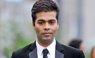 AGAIN Karan Johar gives back to his hater
