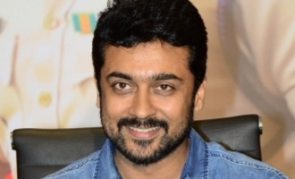 Suriya jumps over a gate to escape fans