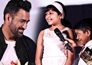What did Dhoni interact with Suriya's kids?
