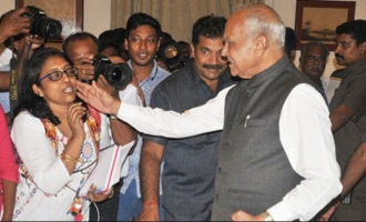 Governor gets into fresh controversy by patting female scribe's cheeks
