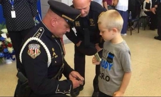 Video: Police officers' endearing gesture for boy who lost his father in line of duty