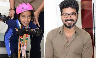 Vijay meets and congratulates a National sports champion kid