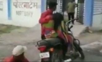 Son carries dead mother on bike for post mortem